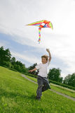 Boy play with kite Royalty Free Stock Images