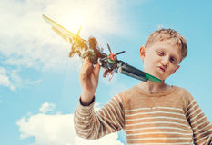 Boy play with model military plane Royalty Free Stock Photography