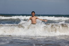 Boy play with ocean Stock Photo
