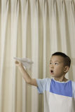 Boy play paper plane Royalty Free Stock Photography