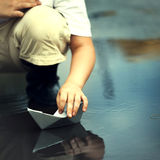 Boy play in paper ship Royalty Free Stock Photography