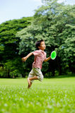 Boy play plastic tennis hand Stock Images