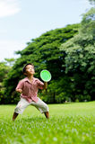 Boy play plastic tennis hand Royalty Free Stock Images