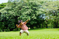 Boy play plastic tennis hand Royalty Free Stock Image
