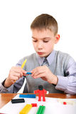 Boy Play with Plasticine Stock Photos