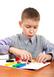 Boy play with Plasticine Stock Images