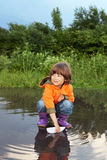 Boy play in puddle Royalty Free Stock Photography