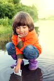 Boy play in puddle Royalty Free Stock Photos