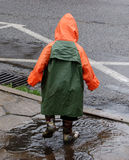 Boy play in rain. Stock Photography