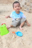 Boy play on sand Stock Photo