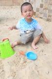 Boy play on sand Stock Photo