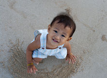 Boy play sand on the beach. Asian boy enjoy first time play sand on beach Royalty Free Stock Image
