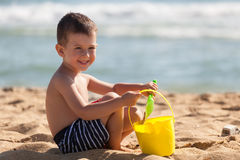 Boy play with sand on summer beach Royalty Free Stock Images