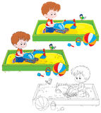 Boy play in a sandbox Royalty Free Stock Photo