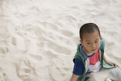 Boy play on sands Royalty Free Stock Images