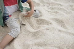 Boy play sands Royalty Free Stock Images