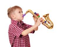 Boy play saxophone. Boy play music on saxophone Stock Photos