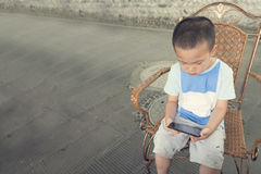 Boy play smartphone Royalty Free Stock Image