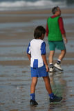Boy play soccer. In the beach Royalty Free Stock Photo