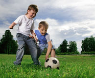 Boy play in soccer Stock Image