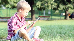 Boy play with tablet stock video
