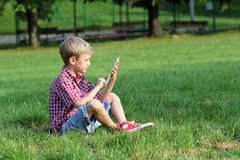 Boy play with tablet pc Stock Photography