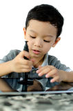 Boy play with tablet pc Royalty Free Stock Photo