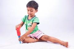 Boy play tool plastic toy on white background Royalty Free Stock Photos