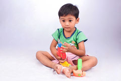 Boy play tool plastic toy on white background Royalty Free Stock Images