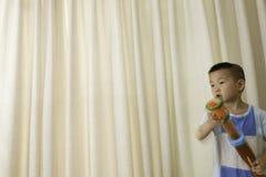 Boy play toy gun Royalty Free Stock Photo