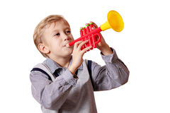 Boy play trumpet Stock Images