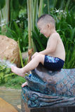 Boy play with water Royalty Free Stock Photos