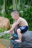 Boy play with water Stock Photos