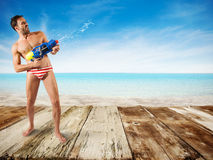 Boy play with water gun Royalty Free Stock Photography