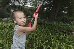 Boy play water gun Stock Photography