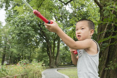 Boy play water gun Royalty Free Stock Photo