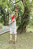 Boy play water gun Royalty Free Stock Images