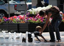 Boy play water with his mom at Sydney Royalty Free Stock Images