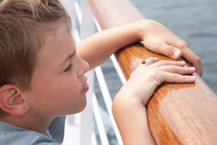 Boy played with ladybird on deck of ship Stock Photo
