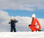 Boy played with mother. Snow. Blue sky Stock Photography