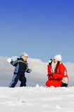 Boy played with mother in winter park Stock Photography