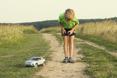 Boy played with a radio-controlled car Royalty Free Stock Photography