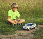 Boy played with a radio-controlled car Stock Photo