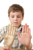 Boy is played by wooden hand of manikin Royalty Free Stock Photos