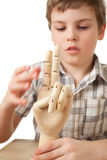 Boy is played by wooden hand of manikin isolated Royalty Free Stock Photo