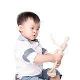 Boy is played by wooden little manikin Stock Image