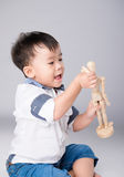 Boy is played by wooden little manikin Stock Photography