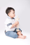 Boy is played by wooden little manikin isolated Royalty Free Stock Images