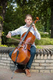 Boy playes on the contrabass Royalty Free Stock Photography