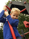 Boy in playground Royalty Free Stock Image